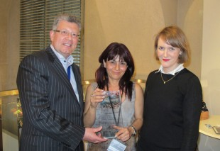 Designer Myriam Soseilos presented by with the Treasure Designer of the Year award by Victoria Bain.